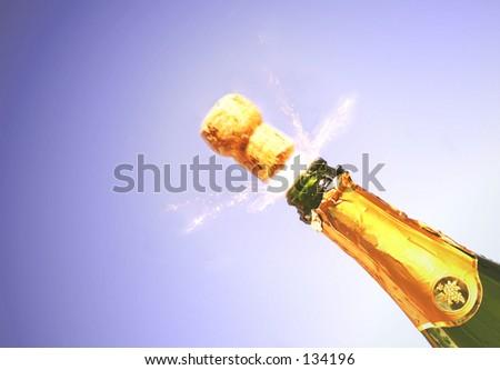 Champagne spraying around cork - stock photo
