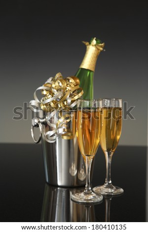 champagne still life on gradient  - stock photo