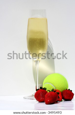 Champagne, strawberries and tennis ball representing Wimbledon tennis tournament - stock photo