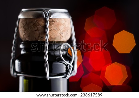 Champagne wine bottle on abstract blur background - stock photo