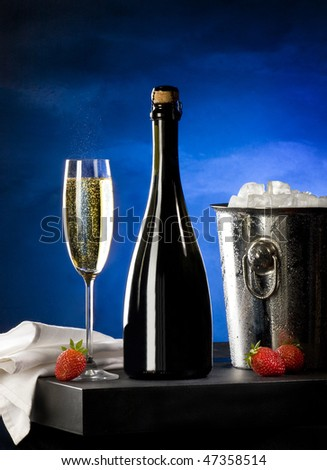 Champagne wine with ice container and strawberry - stock photo