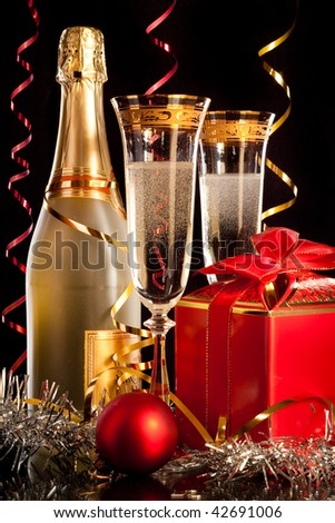 Champagne with christmas balls and the gift - stock photo
