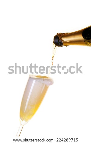 Champagne with froth  in a glass. Isolated on white background