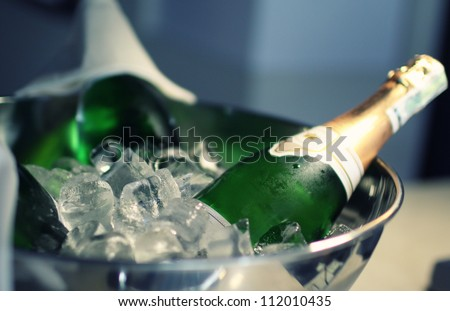 champagne with ice - stock photo