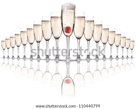 Champagne with strawberry - christmas alcohol cocktail. Isolated on white background - stock photo