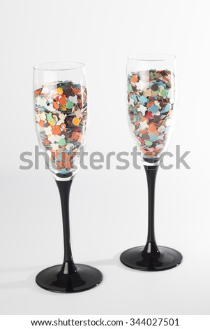 Champaing glasse with confetti, isolated on white background - stock photo