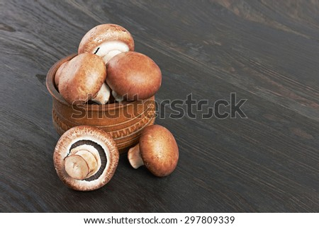 Champignon Mushroom in wooden bowl, on wood background - stock photo