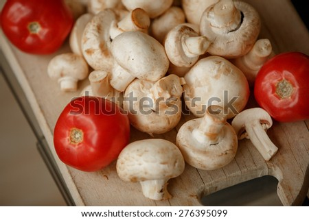 Champignon mushrooms fresh white mushroom slice fungus and tomato, diet and vegetarian, closeup mushrooms, selective focus, series - stock photo