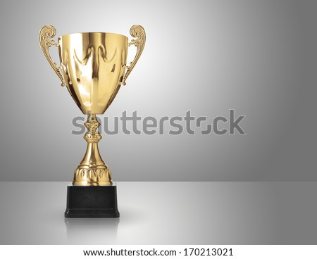 champion golden trophy over grey background - stock photo