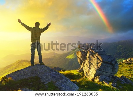 Champion on rocks during sunrise. Beautiful summer landscape - stock photo