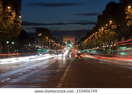 Champs-Elysees avenue at night with the Triumphal Arch in the background, Paris, France - stock photo