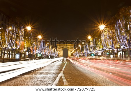 Champs Elysees light on for Christmas day - stock photo
