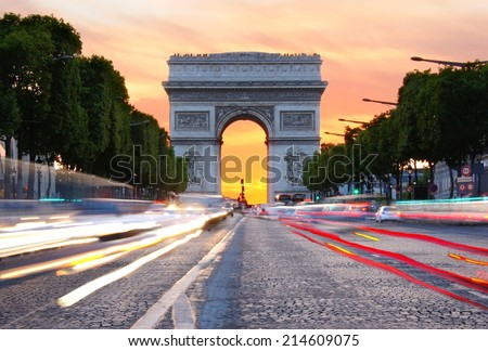 Champs-Elysees towards the Arc de Triomphe at sunset, Paris, France - stock photo
