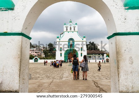 CHAMULA, MEXICO - March 24, 2015: People looking at the church in San Juan Chamula, Mexico - stock photo