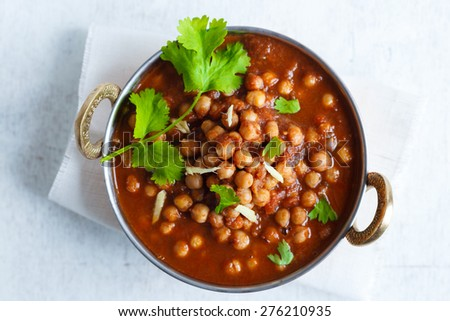 Chana Masala - Spicy Chickpea Curry , Indian Dish Chickpeas soaking in a bed of Onion Tomato gravy, garnished with Coriander leaves and Ginger Juliennes - stock photo