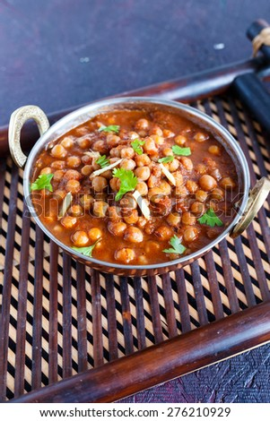 Chana Masala - Spicy Chickpeas Curry garnished with Coriander leaves and ginger juliennes  Indian Dish  - stock photo