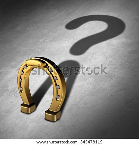 Chance question and luck questions as a horseshoe icon or horse shoe odds symbol as a golden metal lucky charm object as a metaphor for fortune and lotto or lottery success uncertainty prediction. - stock photo