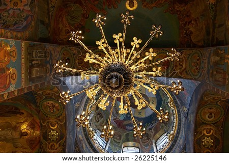 Chandelier and ceiling mosaics in orthodox church - stock photo