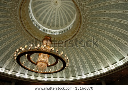 Chandelier and decorated ceiling in a mosque - stock photo
