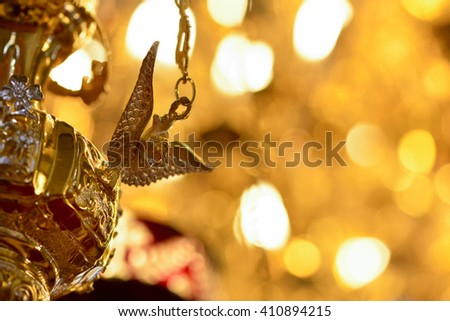 Chandelier church detail in natural light - stock photo