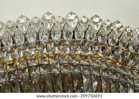 Chandelier hanging under a ceiling  - stock photo