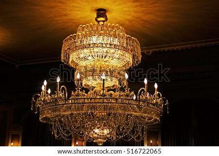 Chandelier hanging under a ceiling in a palace