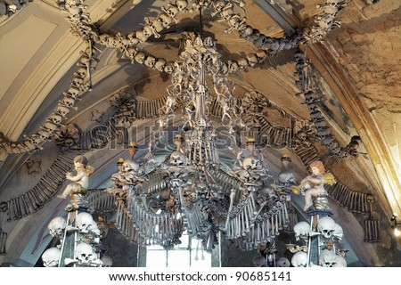 Chandelier made of bones and skulls in Sedlec ossuary (Kostnice), Kutna Hora, Czech Republic - stock photo