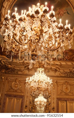Chandeliers hanging under a ceiling. Interiors of the Polovtsov mansion - Architect's house, St.Petersburg, Russia - stock photo