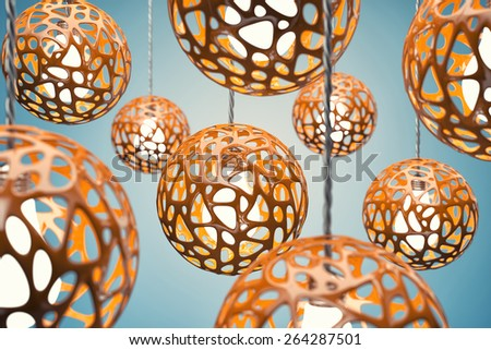Chandeliers of orange colour hang on a wire - stock photo