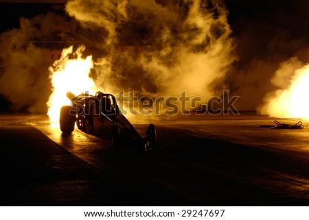 CHANDLER, AZ - APRIL 25: A jet powered drag car ignites its engine at the Firebird International Raceway on April 25, 2009 in Chandler, AZ. - stock photo