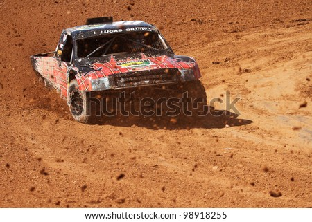 CHANDLER, AZ - MARCH 30: Corry Weller (18) at speed in Pro 4 Unlimited Lucas Oil Off Road Series racing qualifying on March 30, 2012 at Firebird International Raceway in Chandler, AZ. - stock photo