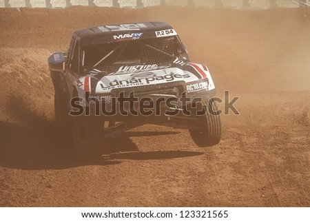 CHANDLER, AZ - OCT 26: Rob Naughton (54) at speed in Pro 2 Unlimited Lucas Oil Off Road Series racing qualifying on October 26, 2012 at Firebird International Raceway in Chandler, AZ. - stock photo