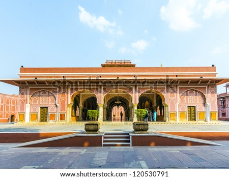 Chandra Mahal in City Palace, Jaipur, India. It was the seat of the Maharaja of Jaipur, the head of the Kachwaha Rajput clan. The Chandra Mahal palace seen in this photo now houses a museum. - stock photo