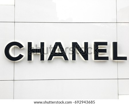 Chanel  logo in front of chanel boutique store at Emquartier Shopping Mall Bangkok Thailand August 8,2017