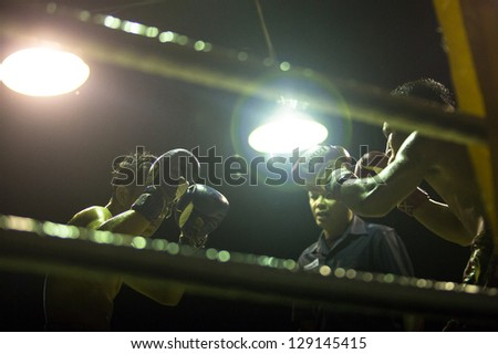 CHANG, THAILAND - FEB 22: Unidentified Muay Thai fighters compete in an amateur kickboxing match, Feb 22, 2013 on Chang, Thailand. Muay Thai practiced over 120000 fans and nearly 10000 professionals. - stock photo