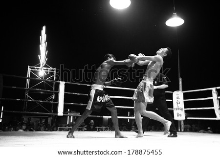 CHANG, THAILAND - FEB 22, 2013: Unidentified Muaythai fighter in ring during match (black and white series). For many Thai men, Muaythai only way to break out of poverty, per battle pay to 7000 baht. - stock photo
