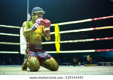 CHANG, THAILAND - FEB 22: Unidentified Muaythai fighter in ring during match, Feb 22, 2013 on Chang, Thailand. For many Thai men, Muaythai only way to break out of poverty, per battle pay to 7000 baht - stock photo