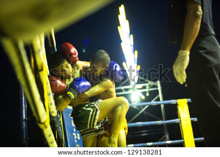 CHANG, THAILAND - FEB 22: Unidentified Muaythai fighters in ring during match, Feb 22, 2013 on Chang, Thailand.For many Thai men, Muaythai only way to break out of poverty, per battle pay to 7000 baht - stock photo