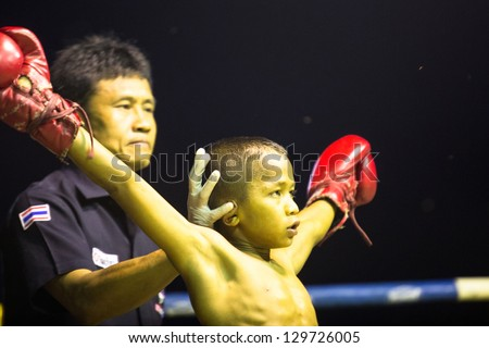 CHANG, THAILAND - FEB 22: Unidentified young Muaythai fighter in ring during match, Feb 22, 2013 on Chang, Thailand.For many Thai men, is only way to break out of poverty, per battle pay to 7000 baht. - stock photo