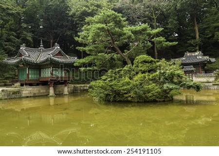 Changdeokgung Secret Garden Pagodas and Pond in Seoul, South Korea - stock photo
