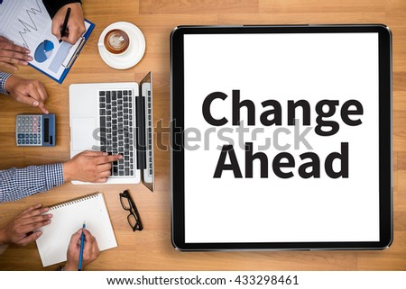 Change Ahead Business team hands at work with financial reports and a laptop - stock photo