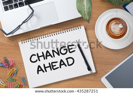 Change Ahead Tablet with blank black screen and coffee cup - stock photo