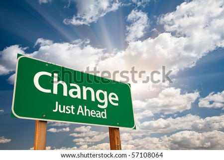 Change Just Ahead Green Road Sign with Dramatic Clouds, Sun Rays and Sky. - stock photo
