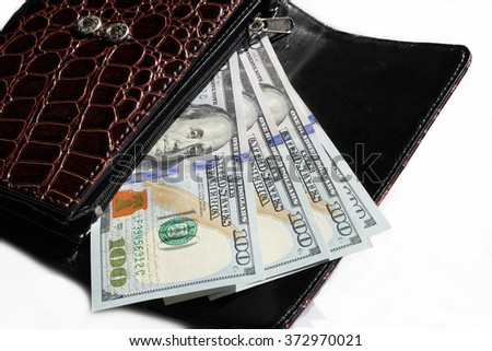 change purse with one hundred dollar bills
