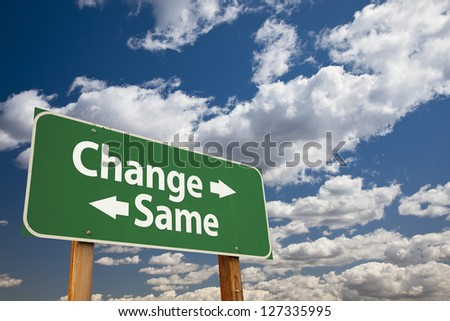 Change, Same Green Road Sign Over Dramatic Clouds and Sky. - stock photo