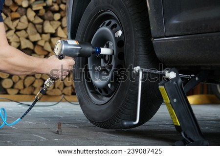 Change tire - stock photo