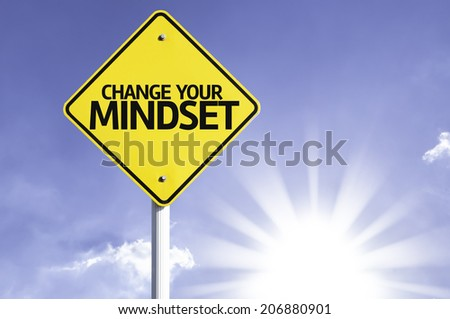Change your Mindset road sign with sun background  - stock photo