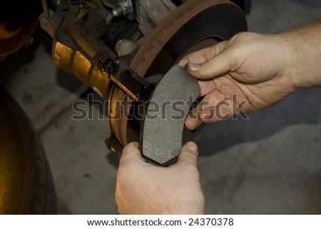 Changing a brake pad - stock photo