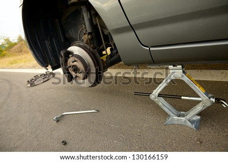 Changing a broken wheel on a car - stock photo