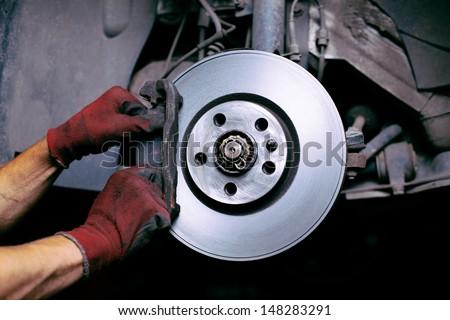 Changing brake pads - stock photo